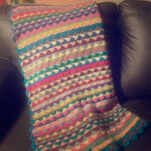 Hand knitted colorful throw blanket.